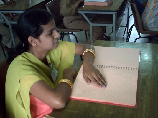 a-visually-handicapped-person-reading-in-braille